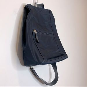 Eddie Bauer Sling Backpack with zippers navy blue